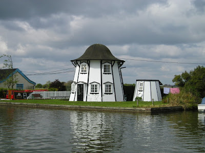 Curious shaped boathouse on the banks of the Thurne between Potter Heigham and Thurne