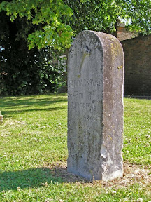 On the left, Basham village green. On the right, Icknield Way milestone - 43 miles to the Peddars Way, 63 miles to the Ridgeway.