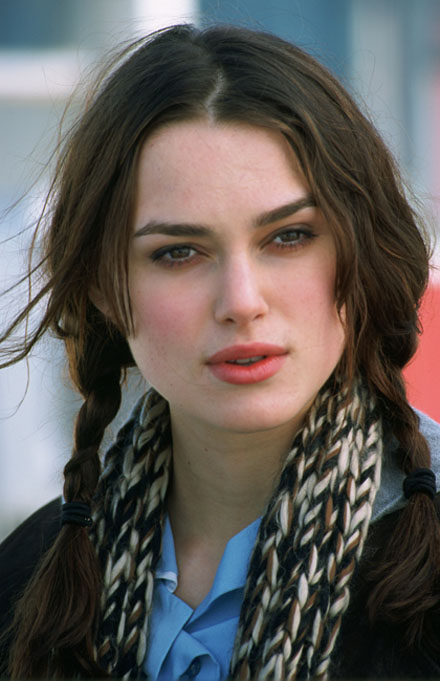 Keira Knightley back in 2004 with a dark wavy hairstyle with bangs.