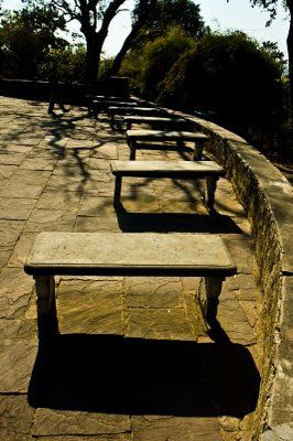 Posted by Vibha Malhotra: Chausath Yogini Temple - Jabalpur : A row of benches outside the complex. The entire complex is circular and so is the position of the benches.