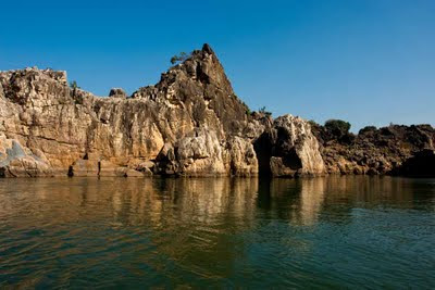 Posted by Vibha Malhotra at www.travellingcamera.com: The Legendary Marble Rocks at Bhedaghat near Jabalpur @ Madhya Pradesh, INDIA: 23 kms from Jabalpur, at Bhedaghat, the river Narmada has carved beautiful formation out of the marble rocks. People have managed to recognize familiar shapes out of these formations. Some of them being Shiv Parvati, Bull's head, Elephant's foot etc. You can book a boat ride to look at these formations.: Reflections of the rock in the river water