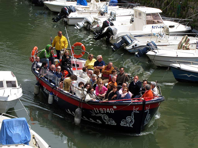 Tourists on a boat cruise along the Fosso Reale, Livorno