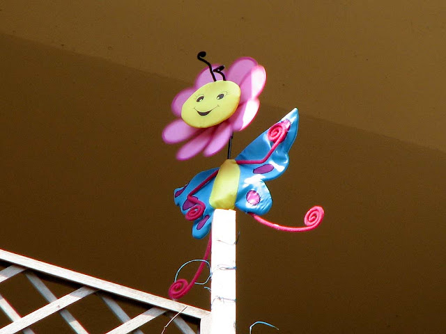 Windmill toy, balcony, Livorno
