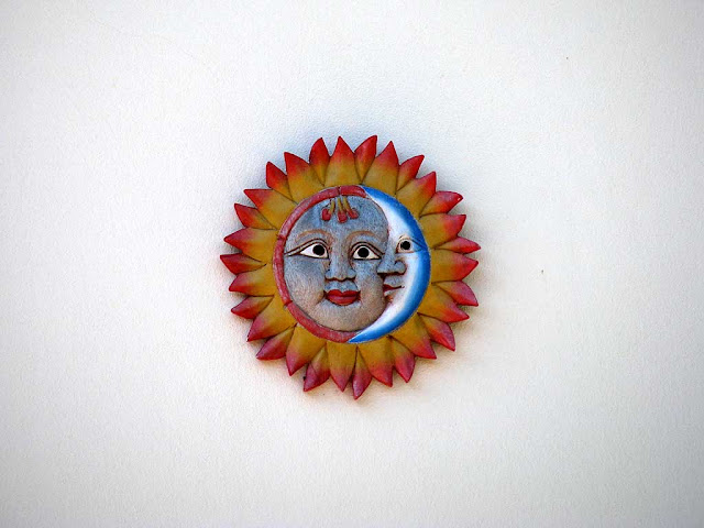 Sun and moon on a wall, Livorno
