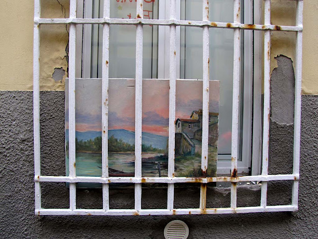 Abandoned painting under the rain, Livorno