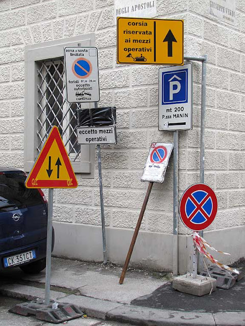 A mess of road signs, Livorno