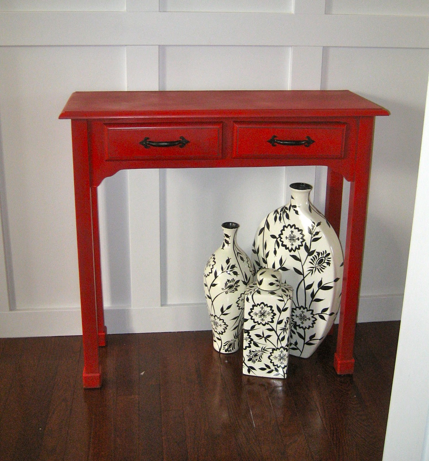 red entry table. red painted and glazed accent table entry d