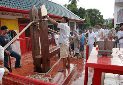 Pole raising at Kathu Shrine, Phuket