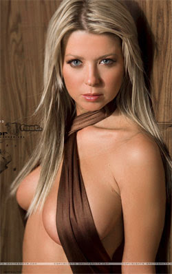 Tara Reid poses topless for Playboy