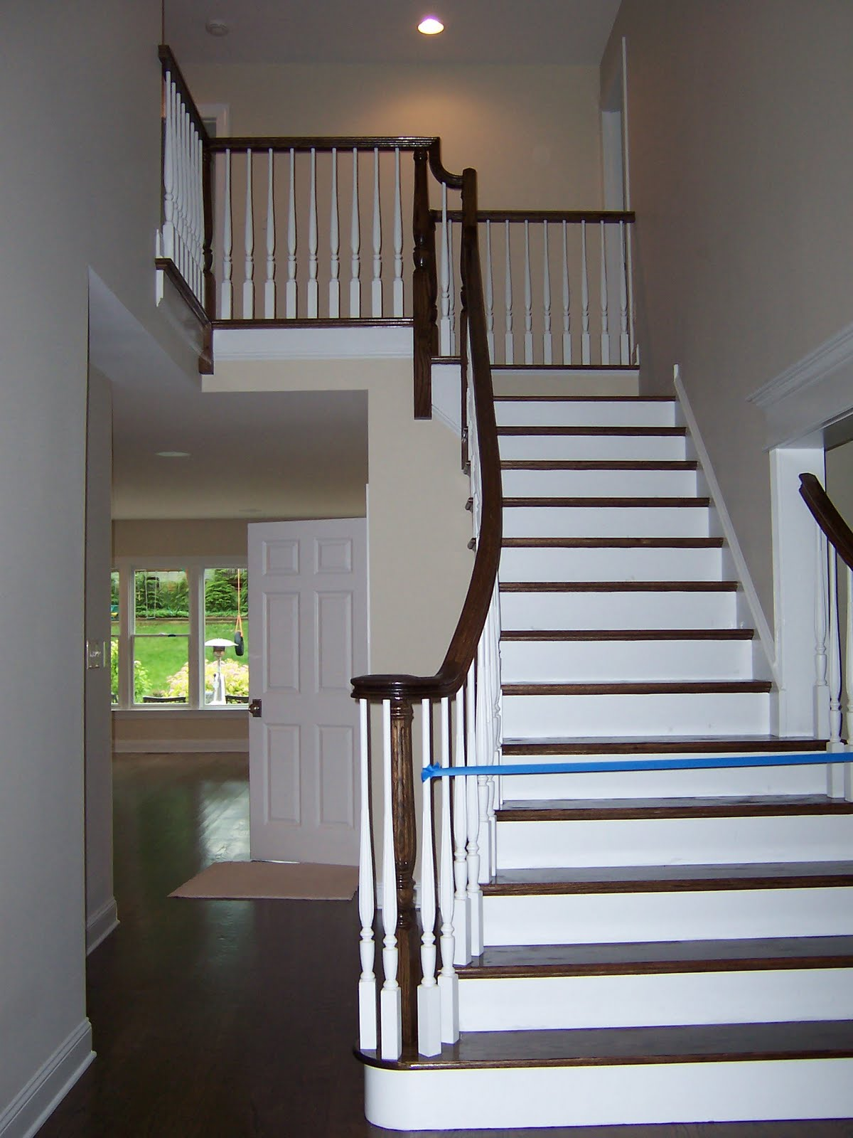 Wood Stairs And Rails And Iron Balusters Flared Oak Stair