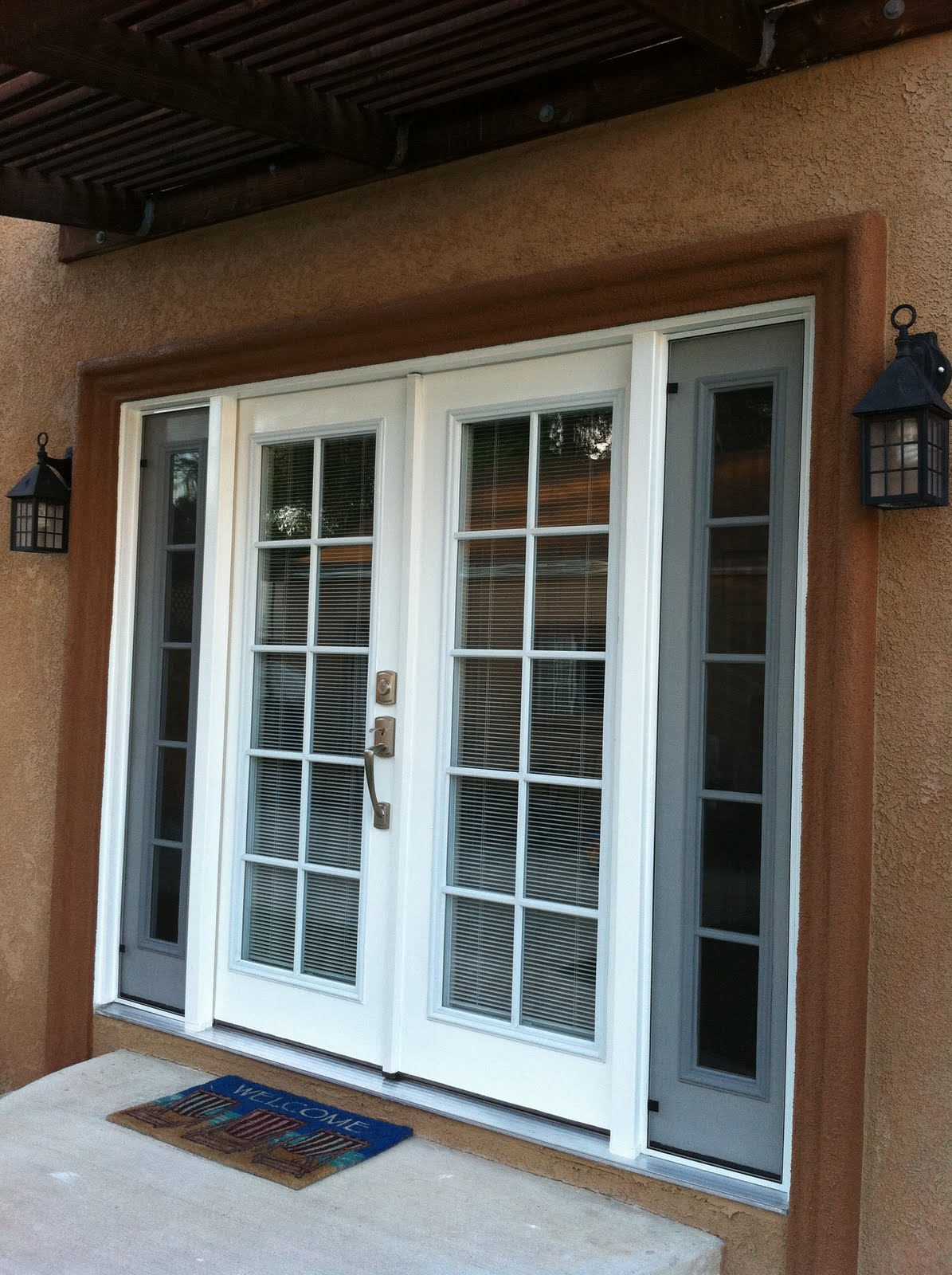 thb construction  back door replaced with double french door with side opening windows