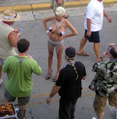Skimpy and sexy costume draws a crowd on Duval Street during Fantasy Fest 2007