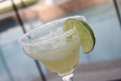 glass with margarita and salted rim and slice of lime