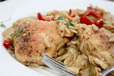 plate with chicken, artichokes, and orzo