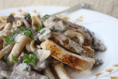 plate with chicken, mushrooms, and creamy pasta
