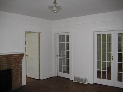 The door to the hall is off the living room.