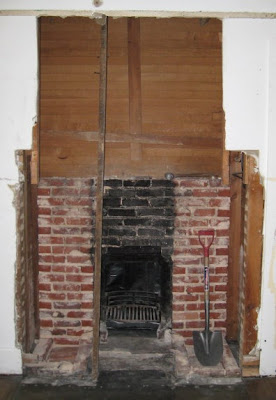 Fireplace opening with chimney breast removed
