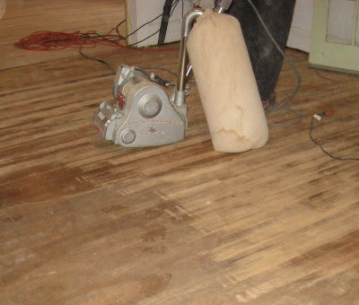 Living room floor getting sanded