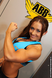 Erica Cordie fitness model flexing