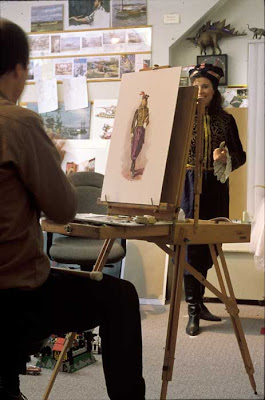 """Sarah, an artwork pupil at East Tennessee State University, asks: """"How did you get inspiration for the costuming that the people in Dinotopia wear? And as someone that has difficulty in creating objects that don't exist in real life, how did you create the accessories used by the dinosaurs?"""