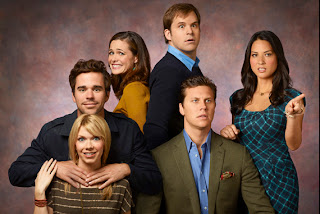 Kyle Bornheimer, standing, Olivia Munn, and the cast of Perfect Couples