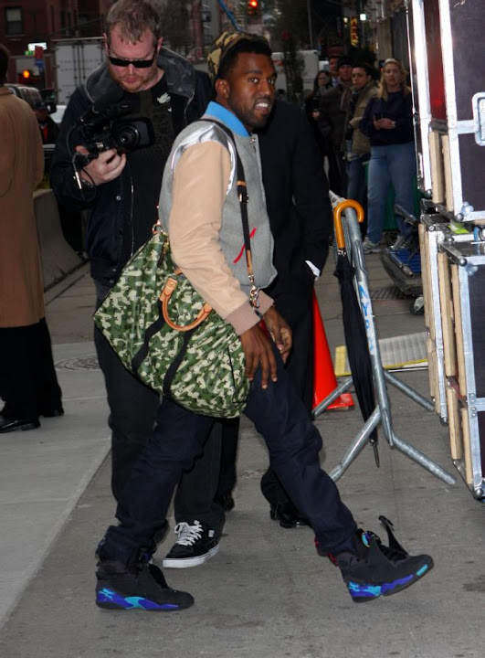 d5fb2fc89161 Kanye West Attracts Attention with His Louis Vuitton Monogramouflage Keepall  55