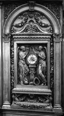 Hand Carved Mahogany Clock at the Grand Staircase