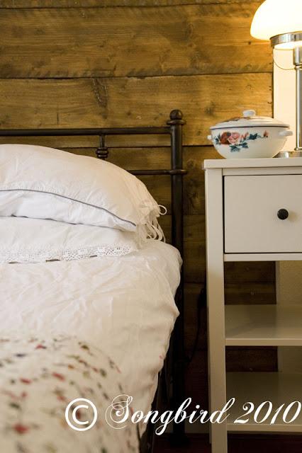 rustic repurposed wood headboard bed room