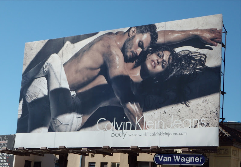Racy Calvin Klein white wash jeans billboard
