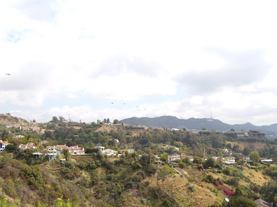 Army helicopters over the Hollywood Sign