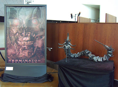 Terminator Salvation robot prop and 3D movie poster