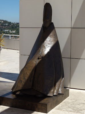 Seated Cardinal sculpture at Getty Center