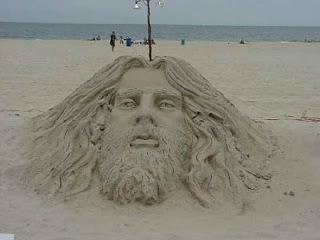 escultura en arena, cara de un hombre