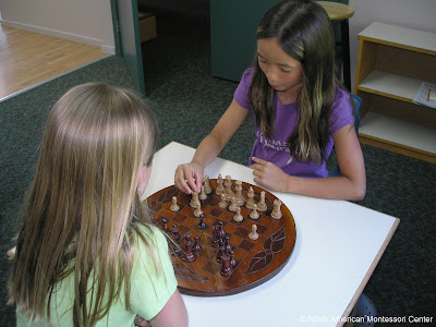 Promoting Parent Involvement NAMC montessori classroom community students play chess