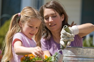 mother's day NAMC montessori activities mother girl gardening