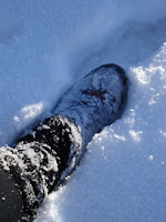 My foot in the thick, soft snow