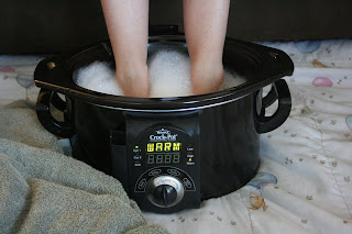 don't be grossed out. Use an old crockpot as a footbath -- it keeps the water at a stable warm temperature and if you have an extra one, why not?!?!