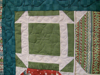 Snowflake Latte Quilt with custom quilting by Angela Huffman - QuiltedJoy.com