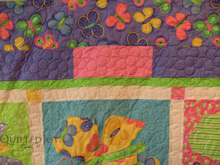 Angela's custom border treatment for the Butterfly Parade quilt - QuiltedJoy.com