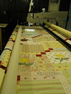Joan's Layer Cake quilt on the APQS Millie frame - QuiltedJoy.com