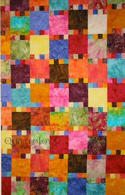 Bright batik quilt, quilted by Angela Huffman