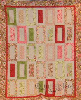 Faye's Feminine Jelly Roll Strip quilt, quilted by Angela Huffman
