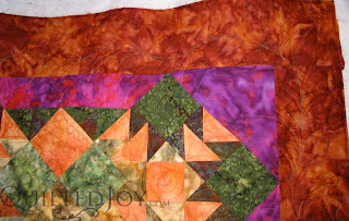 Desert Sands Batik Quilt, custom quilting by Angela Huffman - QuiltedJoy.com
