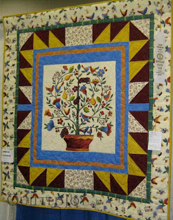 Jubilee Tree, pieced and quilted by Angela Huffman, won third place at the KY State Fair - QuiltedJoy.com