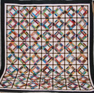 Scraps Strip Quilt for Charity, with quilting by Angela Huffman - QuiltedJoy.com