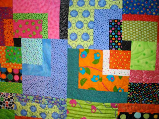 Funky and Modern Log Cabin Quilt with Spiky Spiral Panto, quilting by Angela Huffman - QuiltedJoy.com