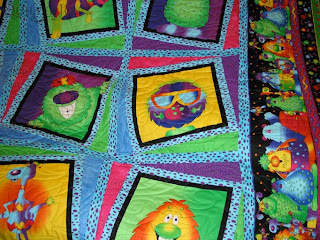 Adorable Monster Quilt, pieced by Wendy Lehman and quilted by Angela Huffman - QuiltedJoy.com