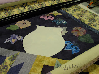 Want to quilt a unique shape? Just use freezer paper! Cut out your shape, iron it flat, and trace with your favorite erasable marker - QuiltedJoy.com