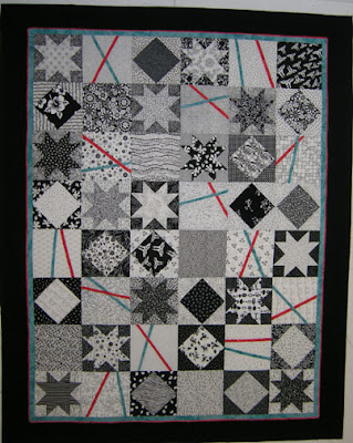 Modern Pick Up Sticks Quilt on the Design Wall - QuiltedJoy.com