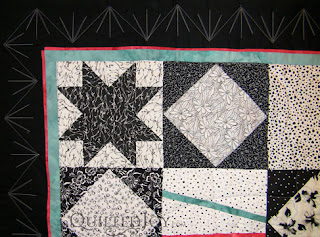 Bold Border Treatment in this Funky Black and White Modern Quilt, with custom quilting by Angela Huffman - QuiltedJoy.com